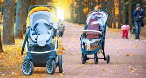 Two toddler prams in park